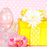 Easter egg, gerber flowers and gift box Royalty Free Stock Image