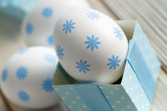 Easter egg in a gift box on wooden planks Royalty Free Stock Photo
