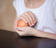 Easter egg in girls hands. Close up girls hands holding Easter egg Royalty Free Stock Image