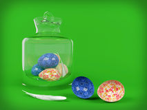 Easter egg in glass jar on green background Royalty Free Stock Photos
