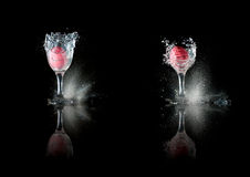 Easter egg in glass is shot. Two glasses with Easter eggs is shot into many pieces with gun at black background stock images