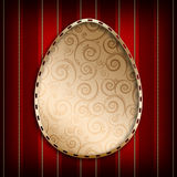 Easter egg in golden frame on red background Royalty Free Stock Photos