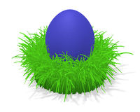Easter egg in grass. 3d illustration of a blue easter egg in a tuft of grass Stock Photo
