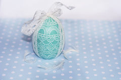 Easter egg green  candle with white ribbon Royalty Free Stock Images