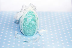 Easter egg green  candle with white ribbon Stock Images