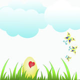 Easter egg  in green grass under blue sky. Easter egg with heart in green grass under blue sky Royalty Free Stock Photo
