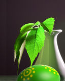 Easter egg and green leaf Royalty Free Stock Photos