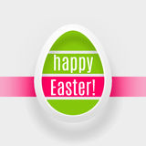 Easter Egg of green and red stripes bordered by a white paper st. Rip casting a shadow with the inscription Happy Easter! on a white background Stock Images