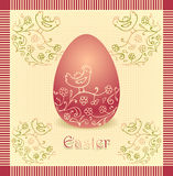 Easter egg with hand drawing beige dark red color Royalty Free Stock Image