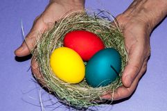 Easter egg in the hands of an elderly person. Royalty Free Stock Photos