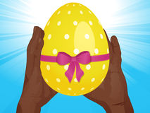 Easter egg and hands Stock Photo