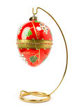 Easter egg  hanging on golden stand Stock Images