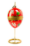 Easter egg  hanging on golden stand Royalty Free Stock Image