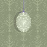 Easter Egg Hanging on a Purple Ribbon Stock Images