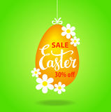 Easter egg hanging on a string with flowers as a sale tag Royalty Free Stock Photography