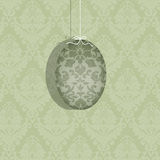 Easter Egg Hanging on a White Ribbon Stock Photo