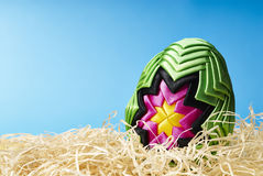 Easter egg in hay Stock Photo
