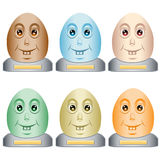Easter egg heads on a base. Cartoon style easter egg heads sitting on a gray base with a blank plaque for copy text. Six assorted colors. Isolated on white royalty free illustration