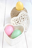 Easter egg in a heart shaped box and  ball of hemp rope Royalty Free Stock Photos