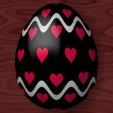 Easter egg with hearts and wavy lines Royalty Free Stock Images