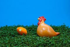 Easter egg and hen on cress Stock Photos