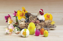 Easter. Egg and hen on a nest Stock Photos