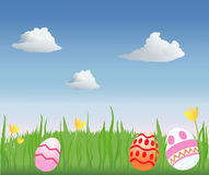 Easter Egg Hunt. Decorated Easter eggs in a grassy field Royalty Free Stock Images