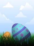 Easter egg hunt. Vibrant Easter eggs hidden in the grass Royalty Free Stock Photo