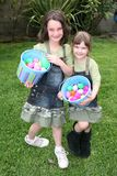 Easter Egg Hunt. Two Young Children Smiling After Hunting for Easter Eggs Royalty Free Stock Photos