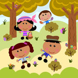 Easter egg hunt. Group of cute cartoon kids playing and searching for Easter eggs Stock Images