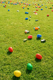 Easter Egg Hunt. Many Easter Eggs and small candies laid out on grass ready for Children to come and hunt them Royalty Free Stock Photos