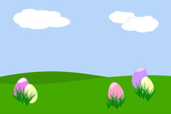 Easter egg hunt. Five pastel colored Easter eggs hidden behind tufts of grass Royalty Free Stock Images