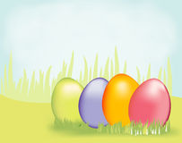 Easter Egg Hunt. Four colorful easter eggs in the grass. Feature your easter egg hunt with this vibrant background Royalty Free Stock Photo