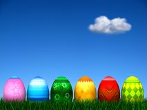 Easter Egg Hunt. 6 Easter Eggs in the grass with an out of focus beautiful blue sky background with a single cloud. See more variations in my Gallery Royalty Free Stock Photos