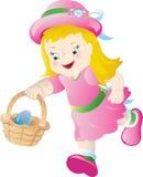 Easter egg hunt. Little girl in pink, hunting for Easter eggs Stock Image