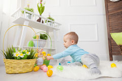 Easter egg hunt. Adorable child playing with Easter eggs at home Royalty Free Stock Photography
