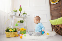 Easter egg hunt. Adorable child playing with Easter eggs at home Royalty Free Stock Image