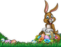 Easter Egg Hunt Bunny Background. An Easter background frame border cartoon with a bunny holding a basket full of Easter Eggs Royalty Free Stock Photos