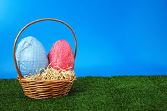 Easter Egg Hunt day. Easter eggs and wicker basket on garden isolated on white background Stock Photo