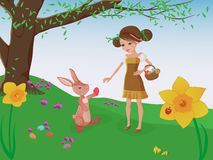 Easter egg hunt. Girl and bunny playing. Easter bunny and a lovely girl playing and helping each other to find easter eggs in a meadow with flowering daffodils Royalty Free Stock Images