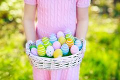 Kids on Easter egg hunt with eggs basket. stock photography
