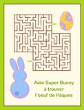 Easter Egg hunt maze or labyrinth game for children. With text i. N french - Help Super Bunny find the Easter egg Royalty Free Stock Images