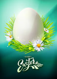Easter Egg Hunt poster on blue. Realistic Egg Hunt poster with typography Hello Easter. Vector illustration. Greeting banner with calligraphy, green grass and Stock Photos