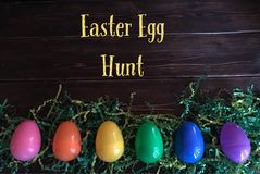 Easter egg Hunt sign with plastic eggs stock photography