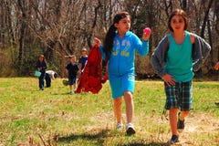 Easter Egg Hunt. Two Young Girls Enjoy an Easter Egg Hunt Royalty Free Stock Images