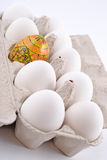 Easter egg and jast eggs in a cardboard box Royalty Free Stock Photo