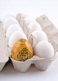 Easter egg and jast eggs in a cardboard box Royalty Free Stock Photography