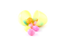 Easter egg with jelly beans over white background Stock Image