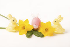 Easter egg in Jonquil primrose. Easter egg in spring flowers with background stock images