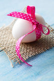 Easter egg on jute Stock Images